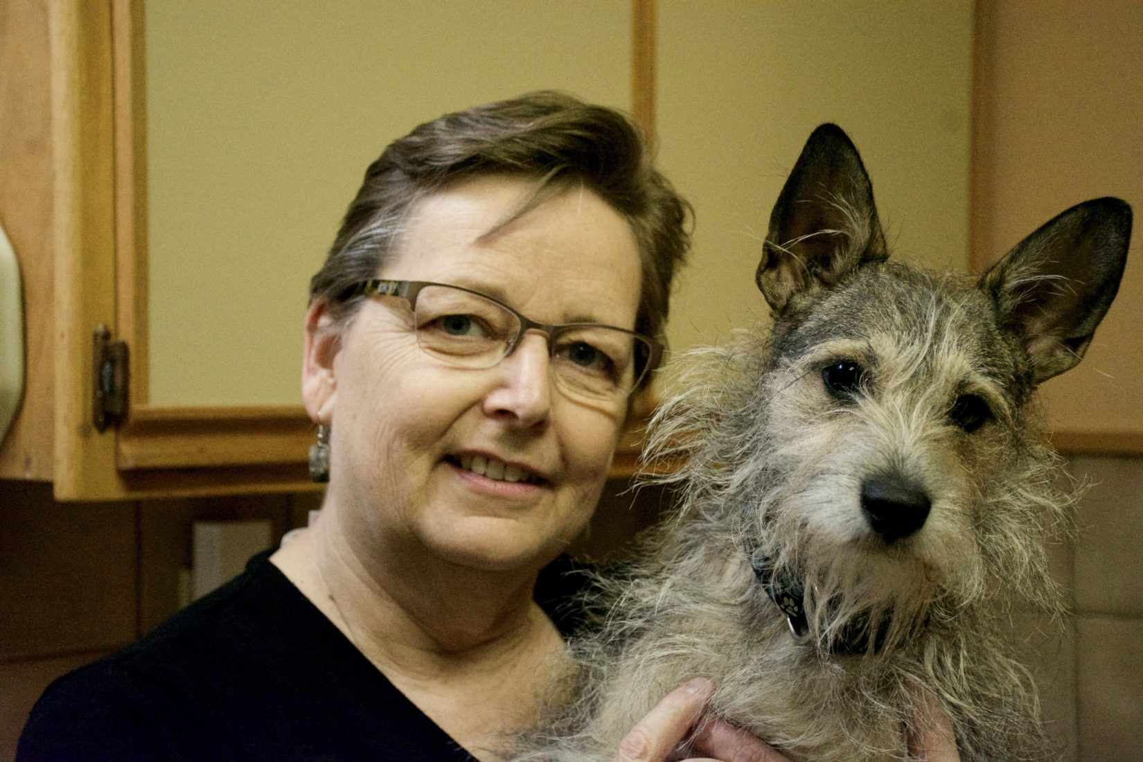 Dr. Holly Tillotson poses with a dog for a photo
