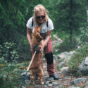 woman hiking outside with dog