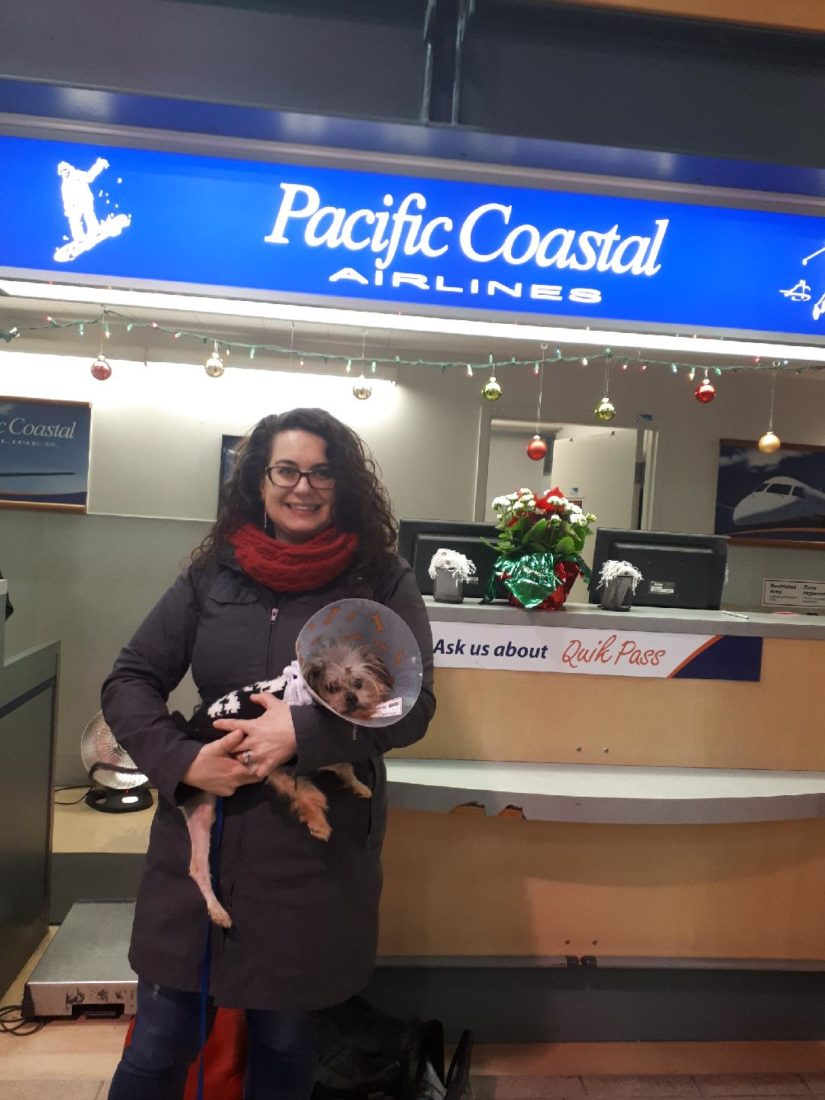 Noel and one of our SPCA volunteers standing in front of the Pacific Coastal Airlines ticketing booth