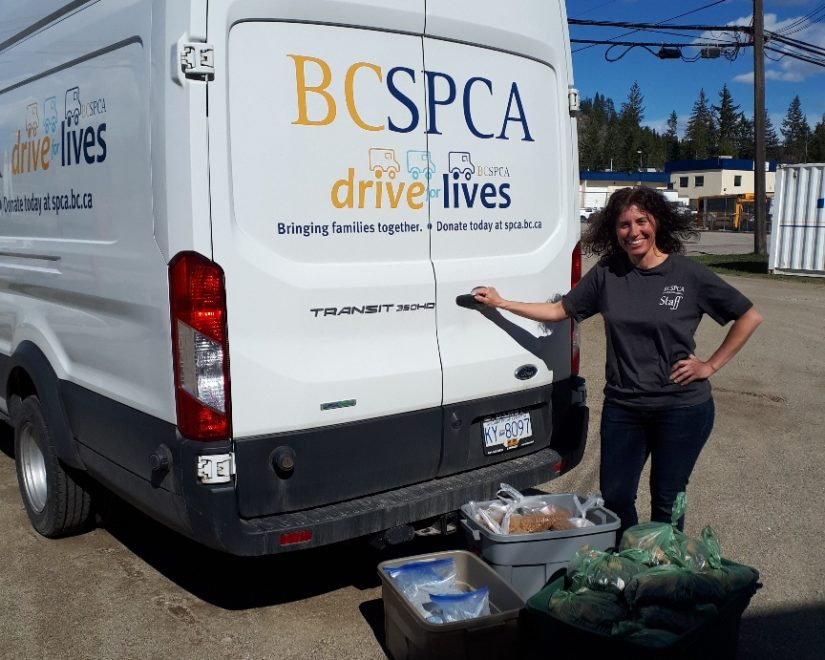 Victoria Olynik outside truck with pet food bank