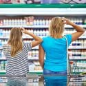 Woman and daughter grocery shopping, confused about what to buy.